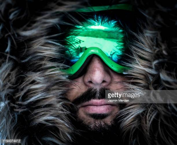 portrait male winter adventurer with goggles - fur jacket stock pictures, royalty-free photos & images
