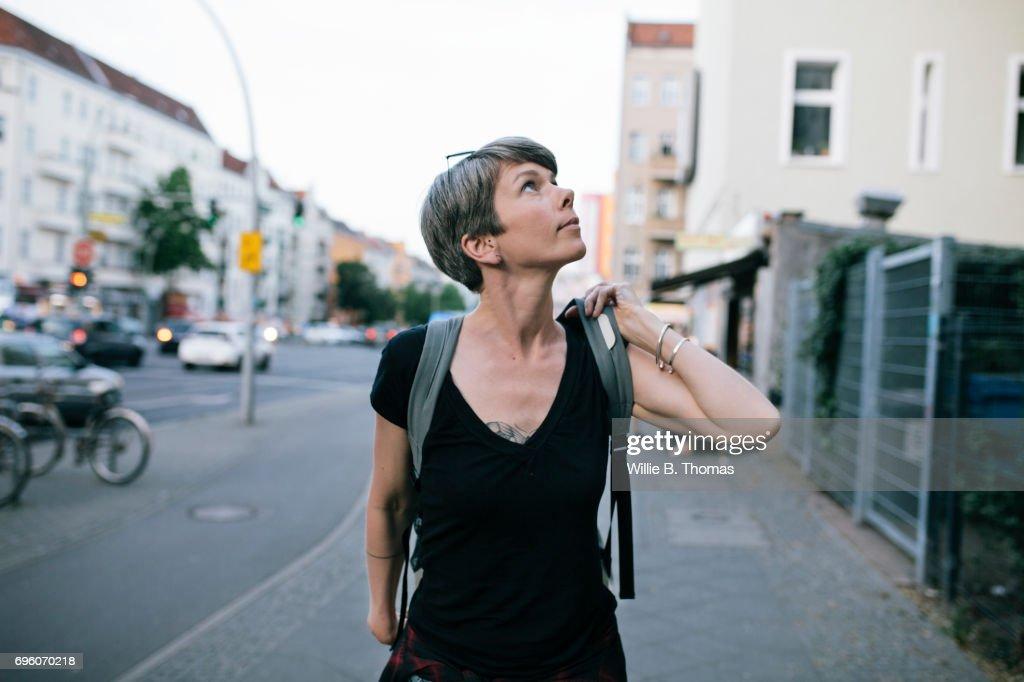 Portrait Mature Backpacker Walking Down The Street : Stock-Foto