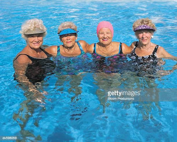 Portrait Mature Friends in a Pool