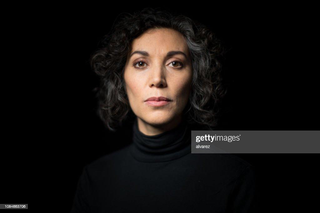 Portrait mature woman staring at camera : Stock Photo