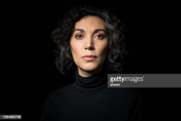 portrait mature woman staring at camera - turtleneck stock pictures, royalty-free photos & images