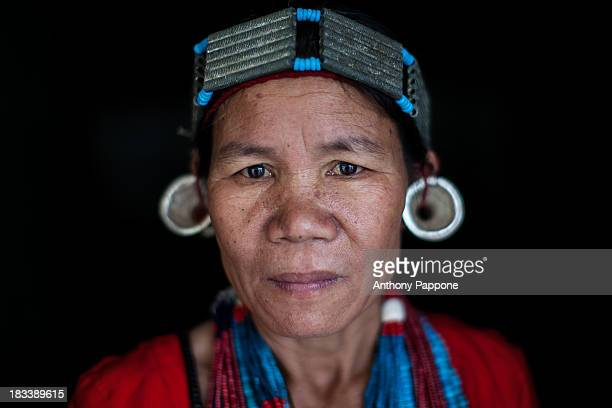 CONTENT] portrait nyishi woman tribe with necklaces and earrings tribal village near Daporijo arunachel pradesh