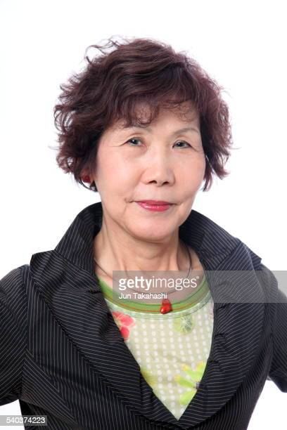Feathered hair stock photos and pictures getty images portrait o japanese woman urmus Images