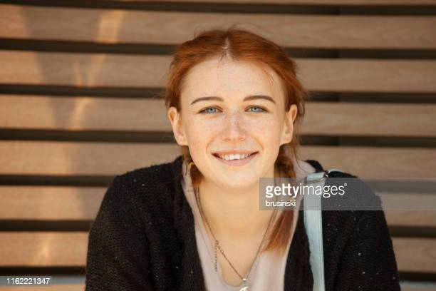 portrait of 18 year old red-haired woman on a city walk - redhead stock pictures, royalty-free photos & images