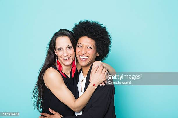 portrait of 2 women embracing and laughing