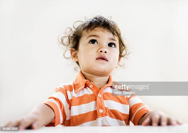 Portrait of 2 year old boy with brown eyes