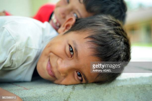 portrait of 2 young boys smiling Banda Aceh Sumatra Indonesia