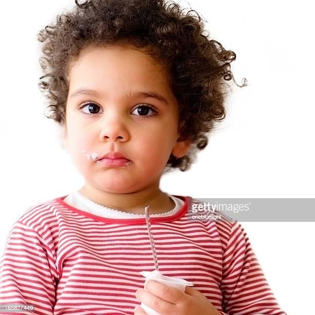 Portrait of 2.5 years old girl Eating Yoghurt