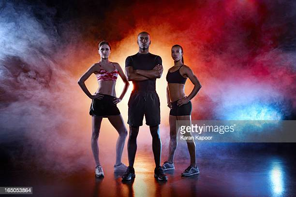 portrait of 3 athletes - three people stock pictures, royalty-free photos & images