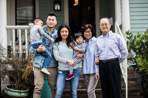 Portrait of 3 generations in front of house - gettyimageskorea
