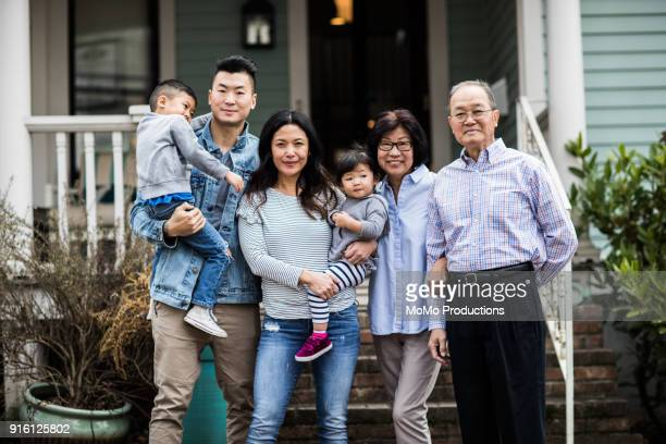 portrait of 3 generations in front of house - portrait photos stock photos and pictures