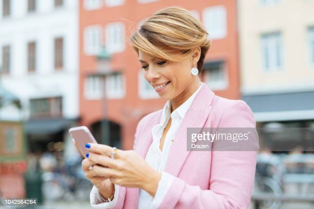 Portrait of 40 year old Scandinavian businesswoman using phone
