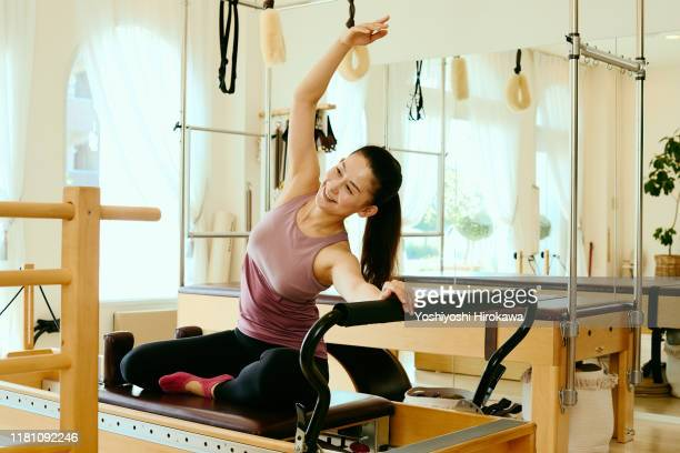 portrait of 46-year-old female small business owner - pilates stock pictures, royalty-free photos & images