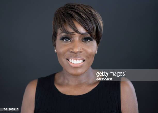 portrait of 47 year old black woman in sleeveless top - sleeveless stock pictures, royalty-free photos & images