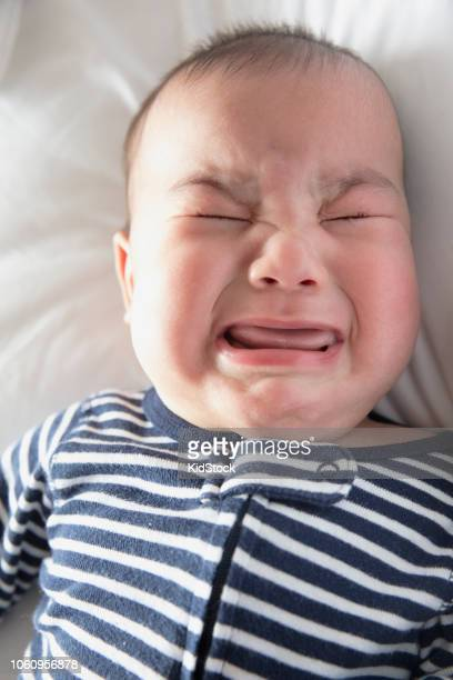 portrait of 5 month old baby crying - one baby boy only stock pictures, royalty-free photos & images