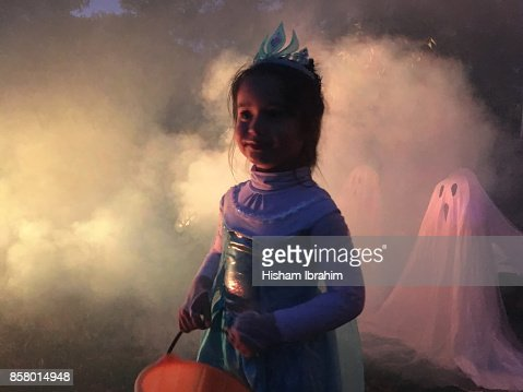 Portrait of 5 years young girl trick or treating in Fairy Costume on Halloween, Washington DC, USA.