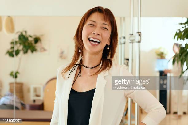 portrait of 53 year old female small business owner - 大人のみ ストックフォトと画像