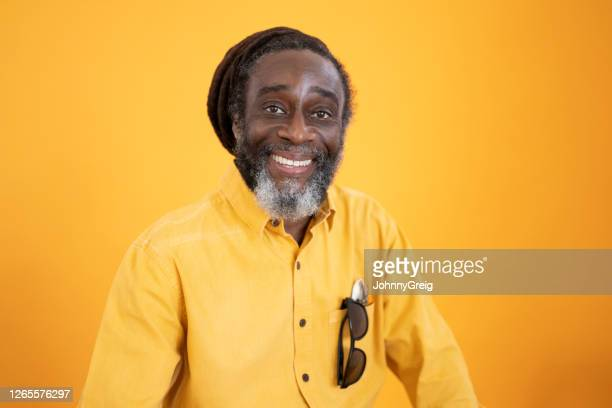 portrait of 57 year old black man with salt and pepper beard - waist up stock pictures, royalty-free photos & images