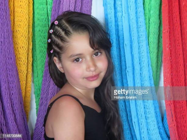portrait of 6 years old girl showing off her braided hair with pride. - コーンロウ ストックフォトと画像