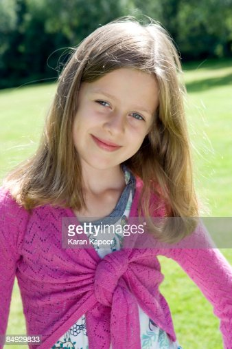 Y R U Black Qozmo Aiire Glitter Sneaker: Portrait Of 9 Year Old Girl Stock Photo