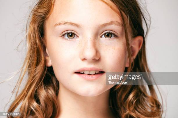portrait of a 10 years old pretty girl  -  child teenager face hair beauty fun eyes freckles - 10 11 years stock photos and pictures