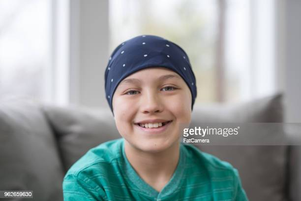 portrait of a 10-year old boy battling cancer in his living room - childhood stock pictures, royalty-free photos & images