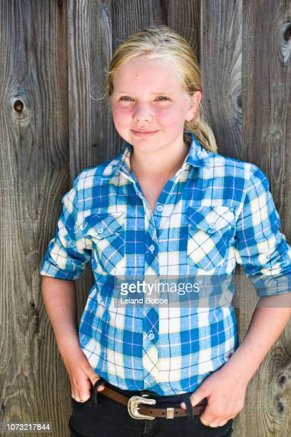 Portrait of a 12 Year old Girl Wearing a Blue Plaid Shirt