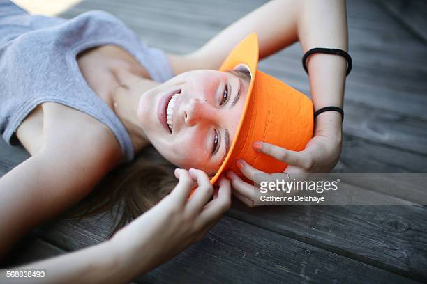 portrait of a 14 years old girl with a hat - 14 15 years stock pictures, royalty-free photos & images