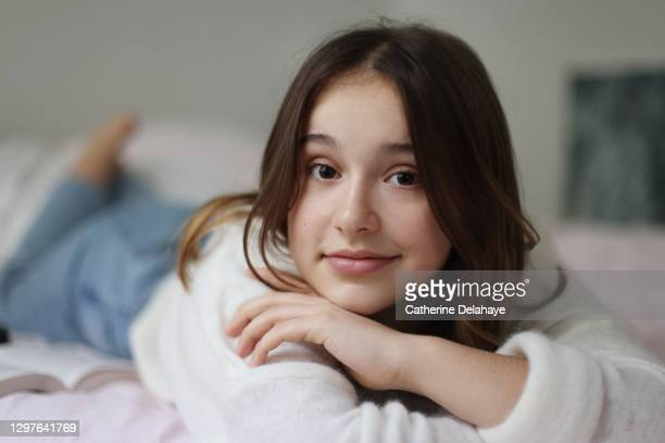 portrait of a 15 years old girl in her room - 14 15 years stock pictures, royalty-free photos & images