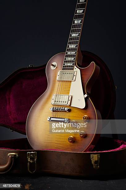 Portrait of a 2013 Gibson Custom 1959 Les Paul Standard Reissue electric guitar photographed in a guitar case taken on August 5 2013