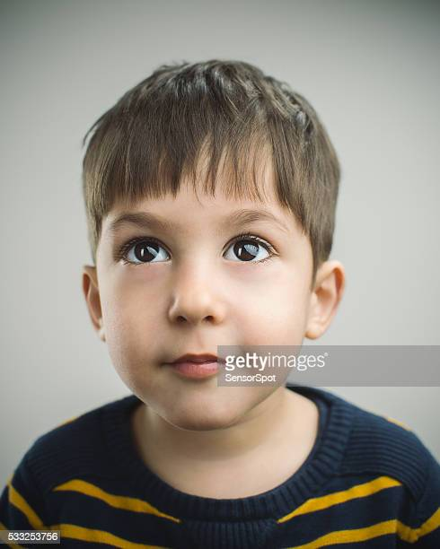 portrait of a 4 years old boy with happy expression - 4 5 years stock pictures, royalty-free photos & images