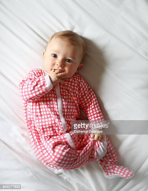portrait of a 6 month old baby girl - delahaye stock photos and pictures