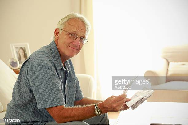Portrait of a 60 year man look at his mail