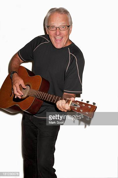 Portrait of a 60 year man playing guitar