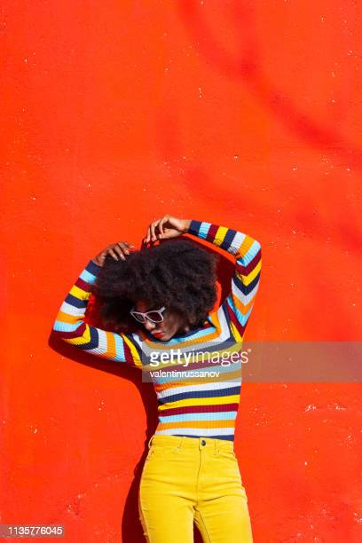 portrait of a afro woman on colorful background - colorful background stock photos and pictures