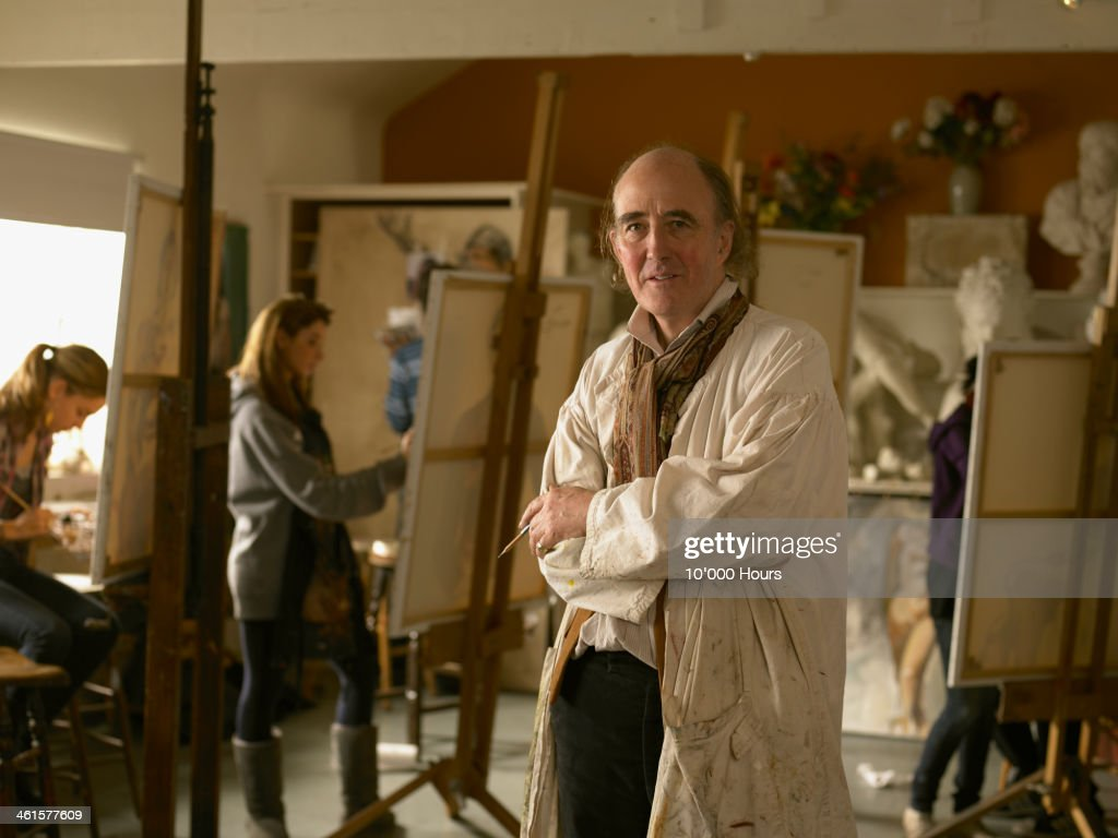 Portrait of a art teacher in his studio : Stock Photo