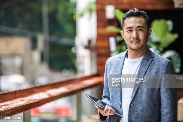 portrait of a asian entrepreneur. - handsome chinese men stock pictures, royalty-free photos & images