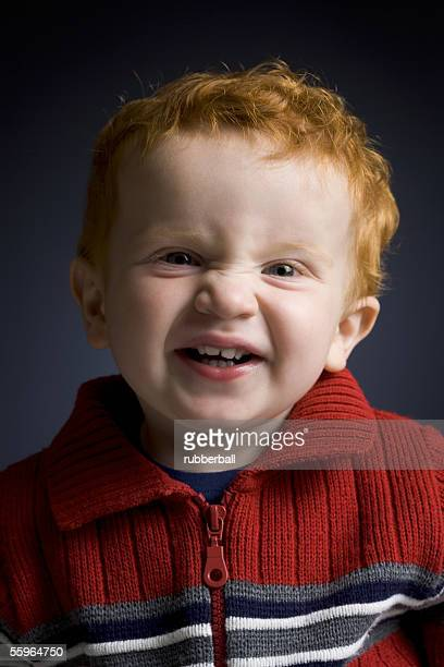 Portrait of a baby boy making a face
