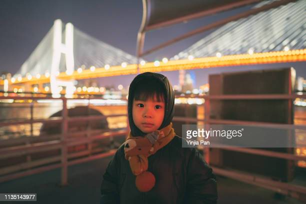 portrait of a baby boy standing on the tour boat and looking at camera - 旅客船 ストックフォトと画像