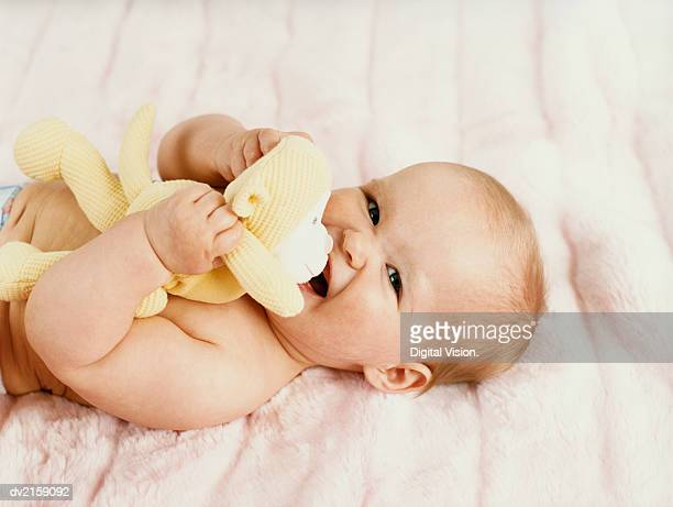 Portrait of a Baby Lying on a Bed