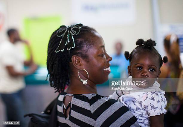 Portrait of a bahamian young mother with her baby girl on June 15 2012 in Nassau The Bahamas
