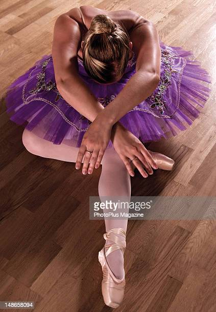 Portrait of a ballet dancer in a crouch taken on August 17 2011