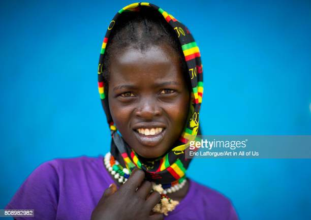 Portrait of a Bana tribe girl in front of a blue wall Omo valley Key Afer Ethiopia on June 8 2017 in Key Afer Ethiopia