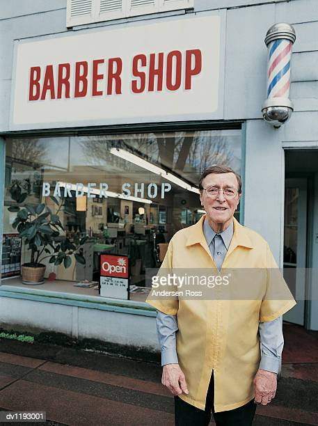 Portrait of a Barber Standing Outside His Barbers Shop
