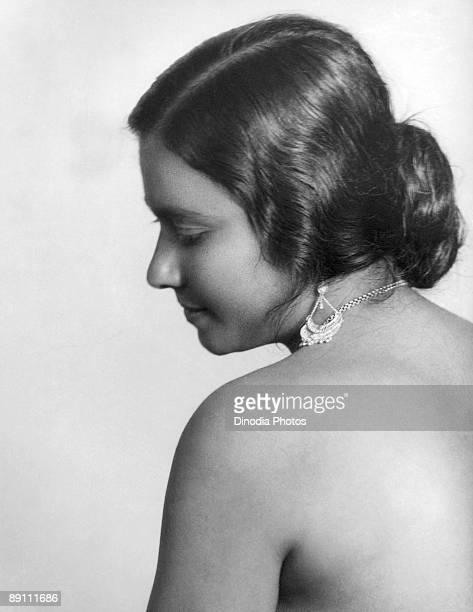 A portrait of a bareshouldered Indian woman in profile Kulri Mussoorie Uttar Pradesh India 1940's