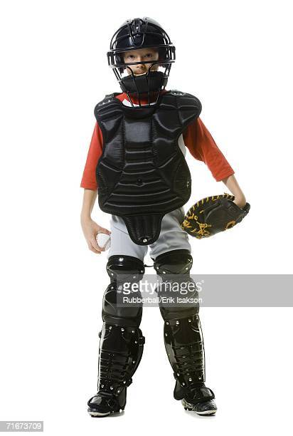 portrait of a baseball catcher standing - baseball catcher stock pictures, royalty-free photos & images