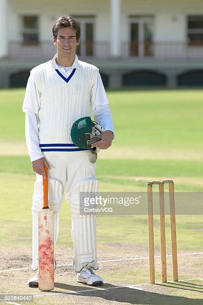portrait of a batsman standing by the wicket - cricket player stock pictures, royalty-free photos & images