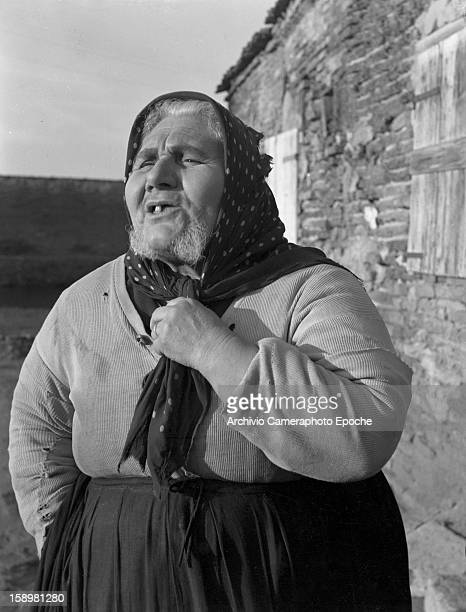 Portrait of a bearded elderly woman outside her house Comacchio Italy 1949