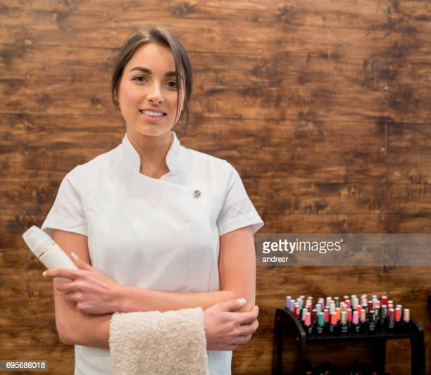 portrait of a beautician working at a spa - nail salon stock pictures, royalty-free photos & images