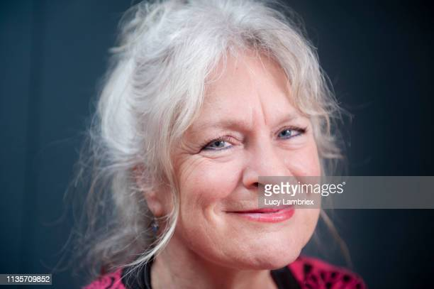 portrait of a beautiful and lively 62-year-old woman - 63 year old female stock pictures, royalty-free photos & images